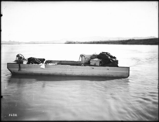Small outboard stranded on a sandbar in the Colorado River, ca.1900